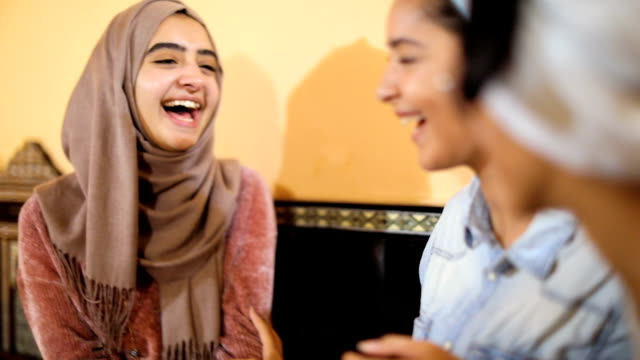 muslim young women having a lunch break together in an arab restaurant - headscarf stock videos & royalty-free footage