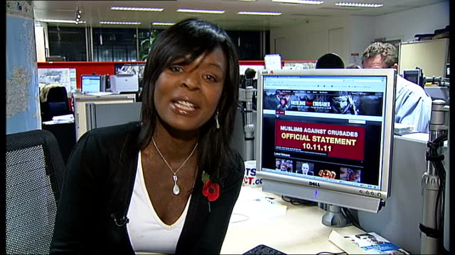 'muslims against crusades' group banned; int reporter to camera ext muslim men selling poppies and poppy wristbands, children buying poppies and... - the crusades stock videos & royalty-free footage