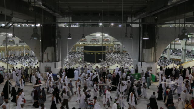 muslims bow or sujod inside masjid haram in makkah. muslims all around the world face the kaaba during prayer time - mecca stock videos and b-roll footage