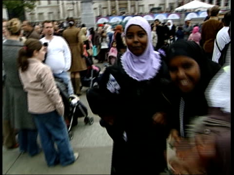 Muslims celebrate Eid in Trafalgar Square to mark end of Ramadan ENGLAND Central London Trafalgar Square EXT Banners 'MCB The Muslim Council of...