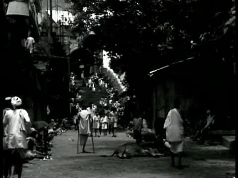 muslims entering muslim temple steps india architect ls indians in slums on street poor areas poverty vs street market woman sweeping holy man... - temple street market stock videos and b-roll footage