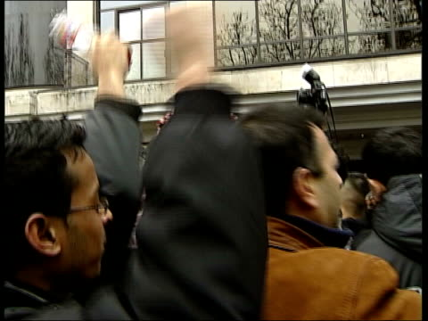 further protests over cartoons england london muslims protesting outside danish embassy about the publication of cartoons depicting the prophet... - publication stock videos & royalty-free footage
