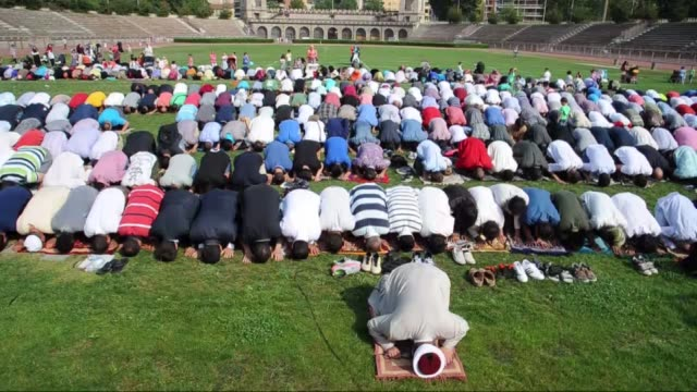 muslims gather at arena civica to perform eid alfitr prayer due to lack of space during the first day eid alfitr on july 05 2016 in milan italy... - religioni e filosofie video stock e b–roll