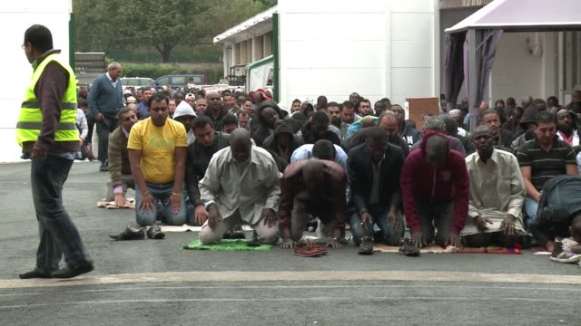 muslims gathered for friday prayer in french capital express their indignation at mohammed cartoons published by french weekly charlie hebdo but also... - france stock videos & royalty-free footage