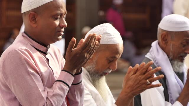 muslims hajj pilgrimage, mecca saudi arabia. - hajj stock videos & royalty-free footage