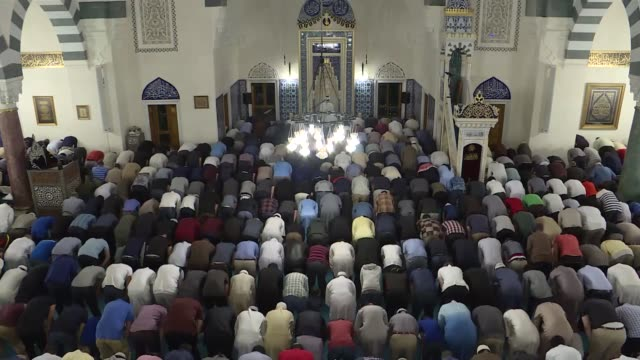 muslims observe laylat alqadr which marks the first revelation of the quran to the prophet muhammad at diyanet center of america in lanham maryland... - muhammad prophet stock videos & royalty-free footage