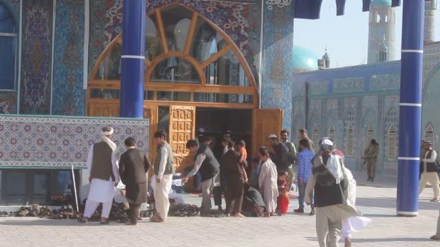 Muslims offer Eid alFitr prayers at the Shrine of Hazrat Ali in MazariSharif Afghanistan on June 25 2017 Muslims around the world will celebrate the...