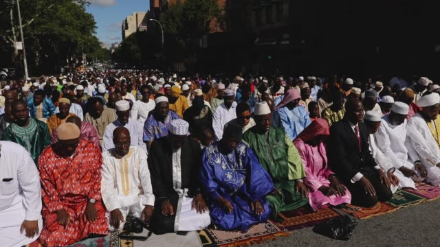 muslims participate in an outdoor prayer event at masjid aqsasalam mosque manhattan's oldest west african mosque to mark the end of ramadan on june... - mosque stock videos & royalty-free footage