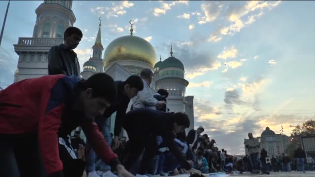 Muslims perform Eid alAdha prayer at the square and streets surrounding the Moscow Central Mosque reopened after reconstruction work in the Prospekt...