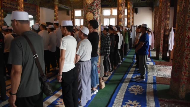 muslims perform eid al-fitr prayer in beijing, china on june 05, 2019. eid al-fitr is a religious holiday celebrated by muslims around the world that... - religion stock videos & royalty-free footage