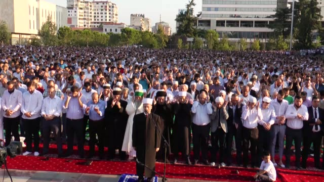 muslims perform eid prayer at skanderbeg square on the first day of the muslim festival of eid aladha in tirana albania on august 11 2019 - tirana stock videos & royalty-free footage
