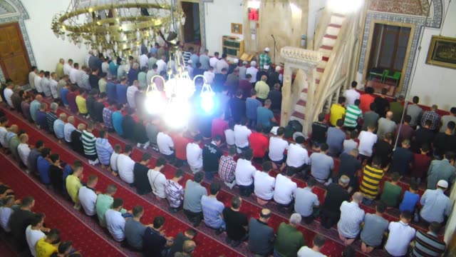 muslims perform prayer at fatih sultan mehmet mosque in pristina on july 01 2016 as they observe the laylat alqadr the night in which the first... - muhammad prophet stock videos & royalty-free footage