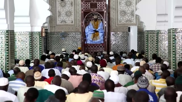 vídeos de stock e filmes b-roll de muslims perform the first friday prayer of ramadan at the dakar grand mosque in dakar senegal on june 19 2015 - senegal