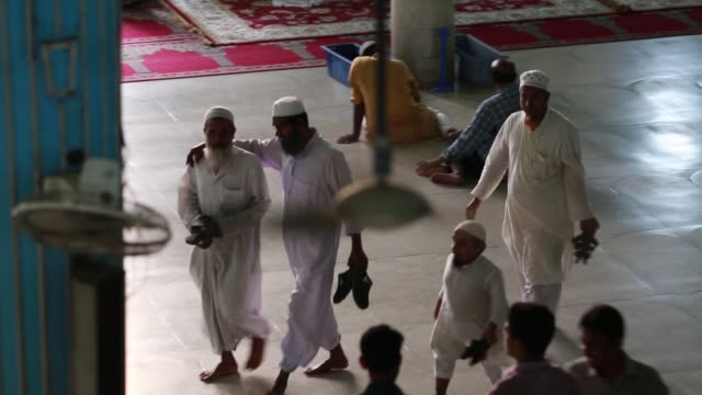 muslims pray during a special prayer at the national mosque of bangladesh to mark shabebarat or 'night of forgiveness' in dhaka bangladesh on may 01... - national mosque stock videos & royalty-free footage