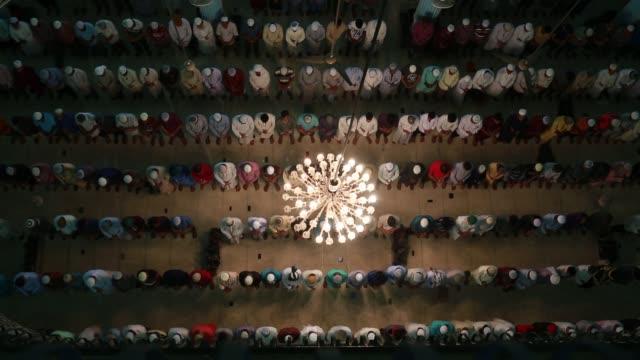 muslims pray during a special prayer at the national mosque of bangladesh to mark shabebarat or 'night of forgiveness' in dhaka bangladesh on may 01... - social gathering stock videos & royalty-free footage