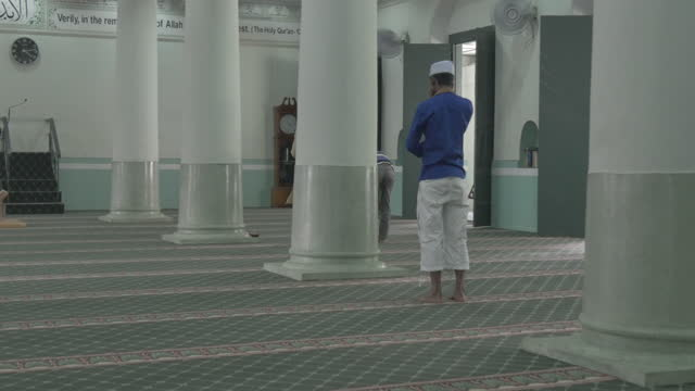 muslims praying in a mosque in singapore of asian origin intercultural and racial friday community prayer singapore sultan majid - malaysian culture stock videos & royalty-free footage