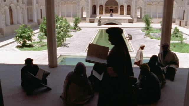 ms, cs, muslims studying koran, iran  - person cross legged stock videos & royalty-free footage