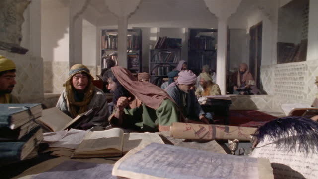 ms, ds, muslims studying koran, iran  - middle eastern culture stock videos & royalty-free footage