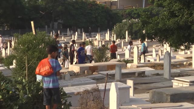 muslims visit tombs of their relatives to pray at jebaliya martyrdom during the eid alfitr holiday in gaza city gaza on july 06 2016 eid alfitr is a... - place concerning death stock videos and b-roll footage