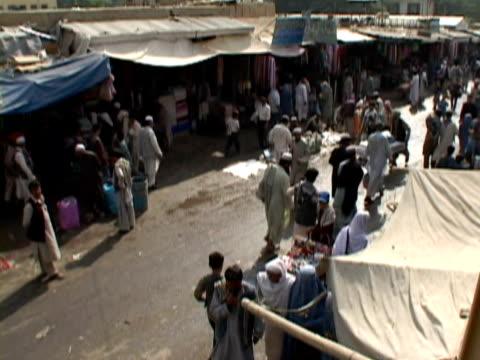t/l ha ws muslims walking at fair, kabul city, kabul, afghanistan - fairground stall stock videos & royalty-free footage