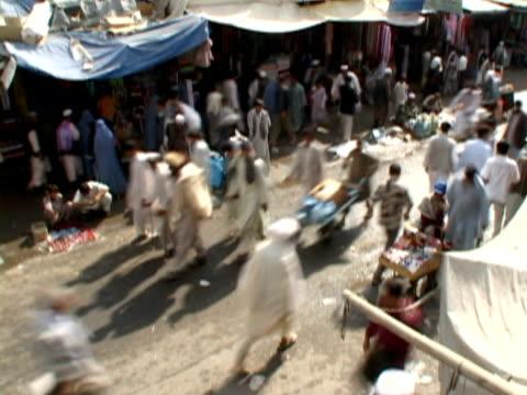 ha ws muslims walking at fair, kabul city, kabul, afghanistan - fairground stall stock videos & royalty-free footage