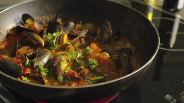 mussels in a pan. - domestic kitchen stock videos & royalty-free footage