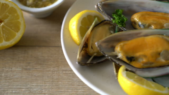 mussels with lemon and parsley - parsley stock videos and b-roll footage