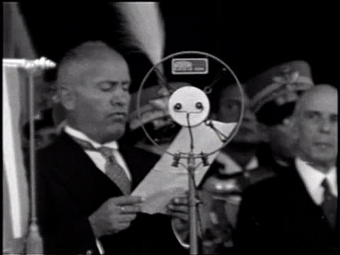 mussolini gives a speech into a large microphone / mussolini in uniform sits on his horse / uniformed officers march past mussolini - benito mussolini stock videos & royalty-free footage