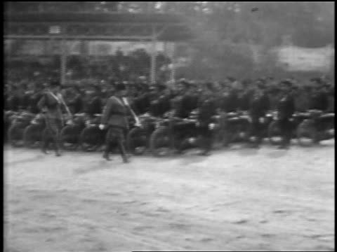 mussolini in uniform walks past police in formation / raises arm in salute / rome - 1929 stock videos & royalty-free footage