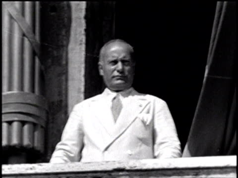 mussolini leans out of a balcony and speaks / he leans over and rests his arm on the balcony - benito mussolini stock videos & royalty-free footage