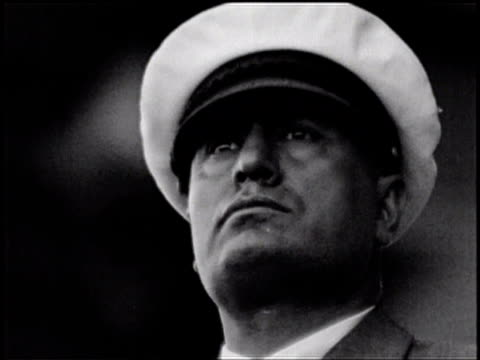 mussolini stands before a crowd wearing a hat/ mussolini looks around - benito mussolini stock videos & royalty-free footage