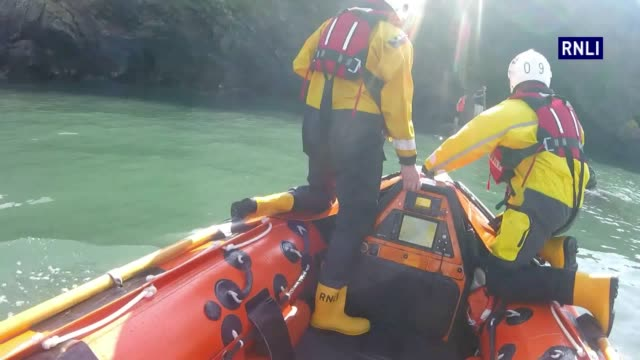 **Must credit RNLI** Footage of the Royal National Lifeboat Institution rescuing a stranded family of three cut off from a tide in Tenby...