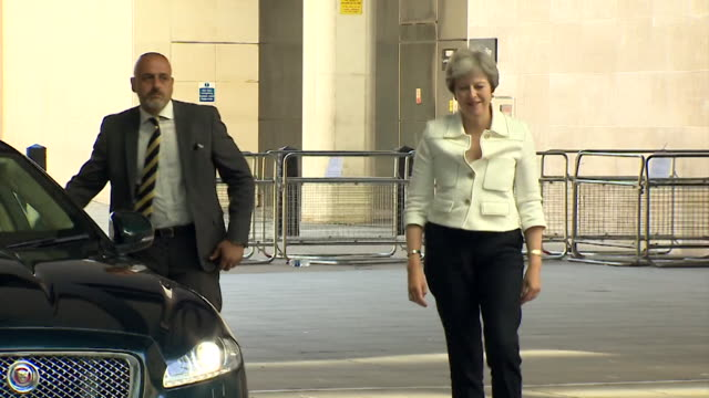 must obtain permission from the andrew marr show before licensing theresa may gets out of a car and walks into the bbc's new broadcasting house in... - theresa may stock videos & royalty-free footage