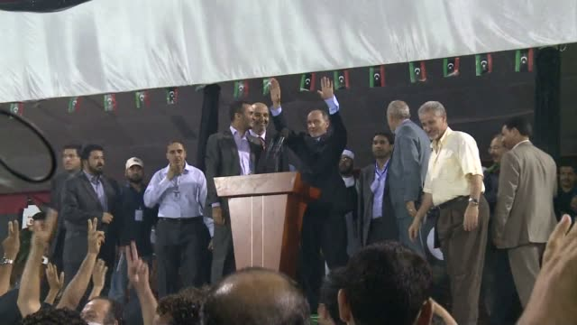 mustafa abdel jalil the head of libya's new leadership was hailed by a crowd of thousands on monday when he made a public appearance in tripoli's... - libyan civil war stock videos & royalty-free footage