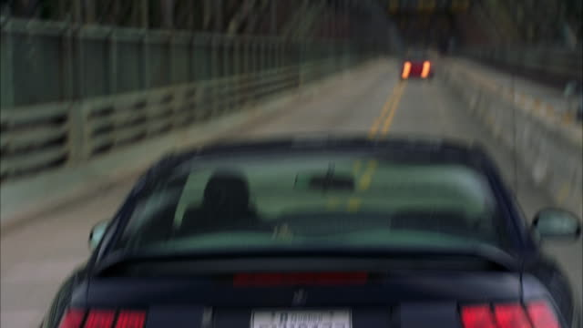 ws pov mustang going on wrong side and encountering cars on bridge - ford mustang stock videos and b-roll footage