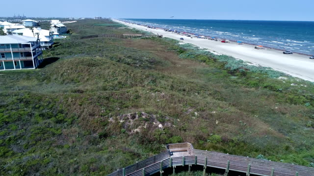mustang island near port aransas over the sand dunes and green wetlands of the beach aerial drone view above padre island - corpus christi texas stock videos & royalty-free footage