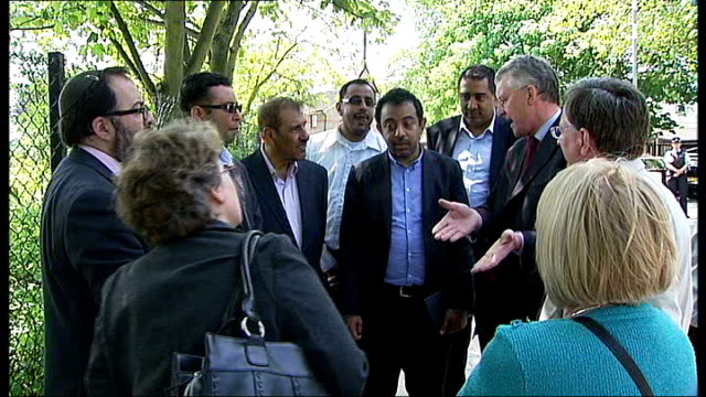 muswell hill islamic centre destroyed in fire antifascist vigil held in response england london muswell hill ext community leaders talking with... - hilary benn stock-videos und b-roll-filmmaterial