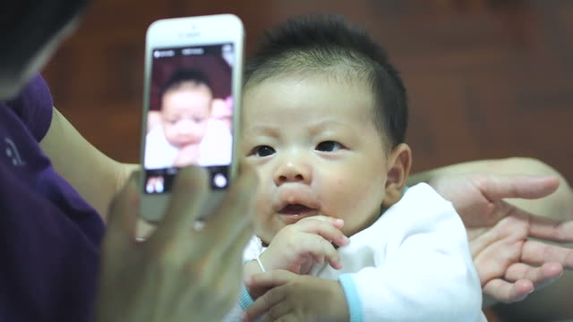 My baby taking a picture on mobile phone