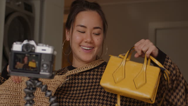 my favourite designer just launched a new line of handbags - instructor stock videos & royalty-free footage