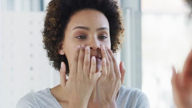 my skin feels amazing already - cream stock videos and b-roll footage