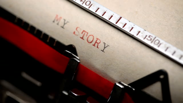 my story - typing with a retro style typewriter - passione video stock e b–roll