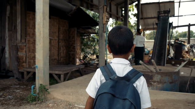 m/s steadycam myanmar boy coming home from school - school child stock videos & royalty-free footage