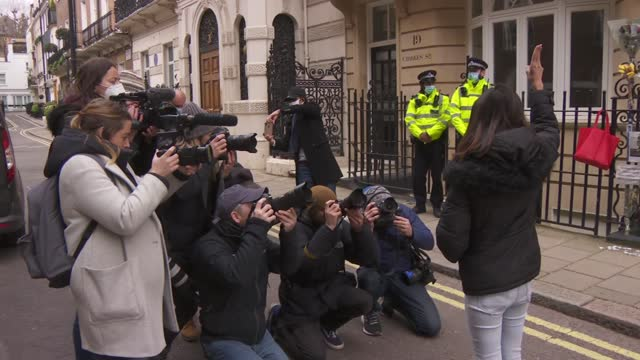 ambassador locked out of london embassy: ambassador followed by press scrum; england: london: mayfair: myanmar embassy: ext protester posing for... - war and conflict stock-videos und b-roll-filmmaterial