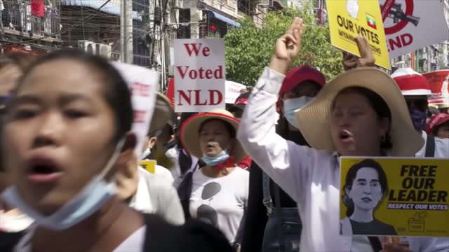 pro-democracy protests continue; myanmar: yangon : ext various shots of pro-democracy protesters singing sot various of demonstrators along with... - protestor stock videos & royalty-free footage
