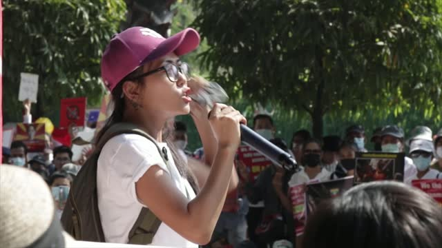 pro-democracy protests continue; myanmar: yangon : protesters with signs 'civil disobedience movement - respect our vote' demonstrators seated... - protestor stock videos & royalty-free footage
