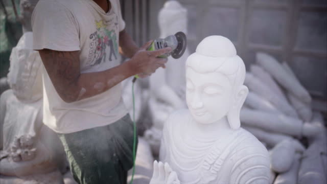 myanmar marble stone craftsman grinding buddha sculpture - stone object stock videos & royalty-free footage