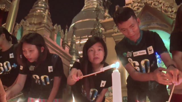 myanmar marks earth hour with a candle display around the shwedagon pagoda - earth hour stock videos & royalty-free footage