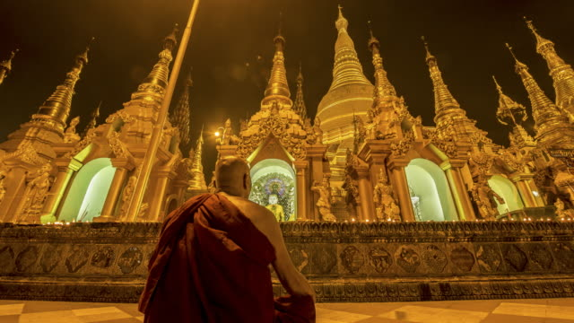 myanmar -monk prays in the largest pagoda in myanmar - pagoda stock videos & royalty-free footage