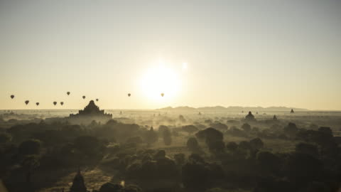 myanmar - sunrise and sightseeing balloons above the ruins of pagoda in the dawn - unesco world heritage site点の映像素材/bロール