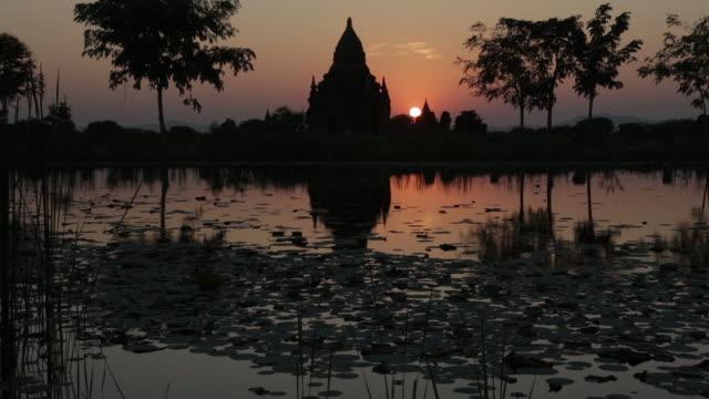 Myanmar sunset temple reflection